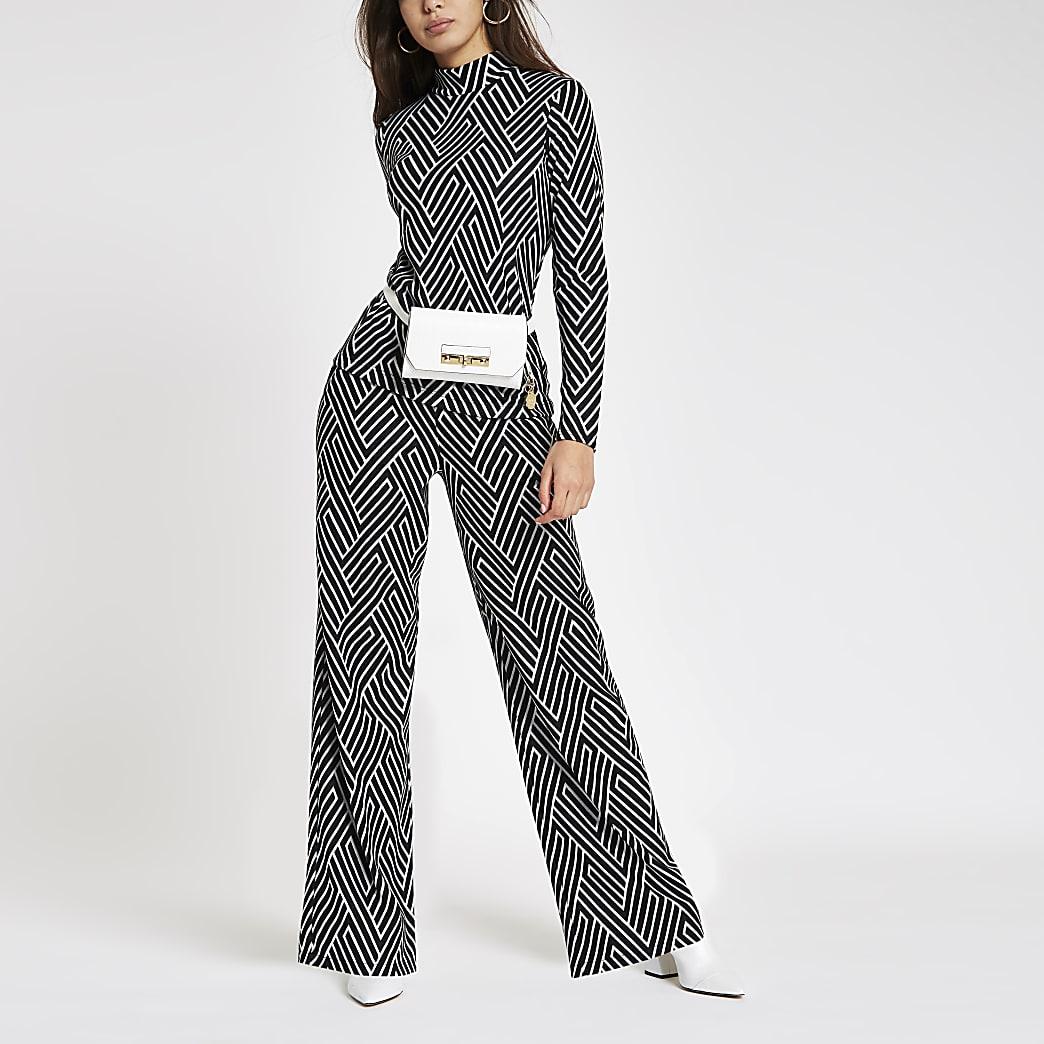 Pantalon large en jersey noir imprimé géométrique