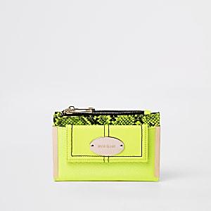 Mini porte-monnaie vert fluo à rabat et poche sur le devant
