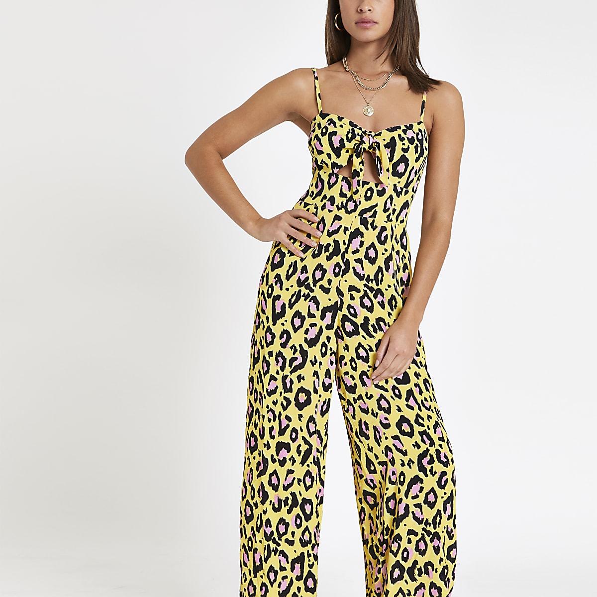 Gele jumpsuit met luipaardprint en strik voor