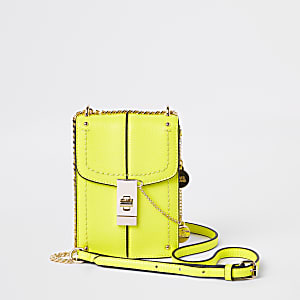 Neon yellow lock front cross body bag