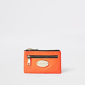 Neon pink mini oval RI branding purse