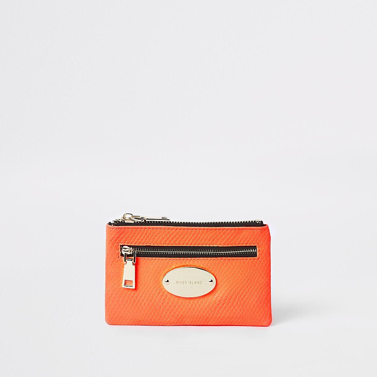 Mini porte-monnaie ovale rose fluo à logo RI