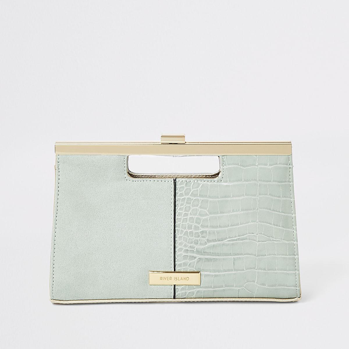 Light green grab handle clutch bag