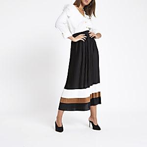 Jupe mi-longue plissée motif colour block noire
