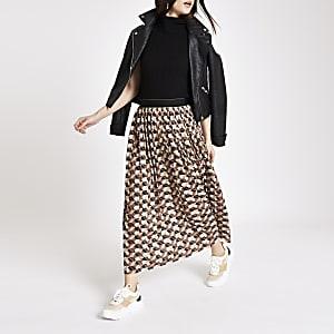 Jupe mi-longue plissée à imprimé géométrique marron