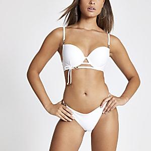Bas de bikini échancré blanc avec strass sur la bordure