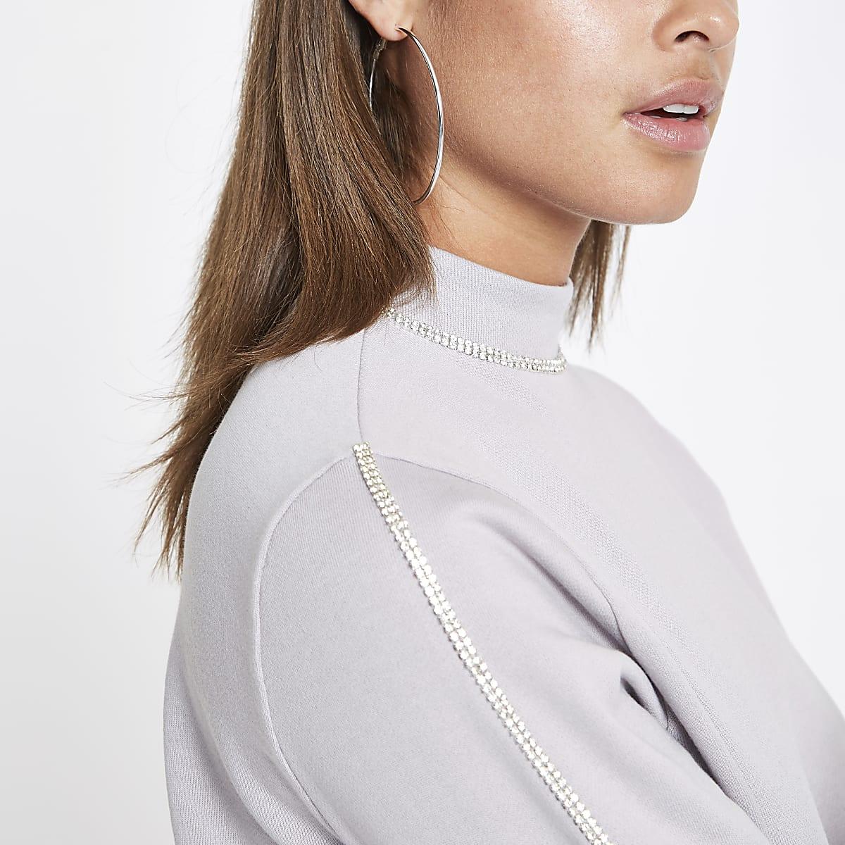 Grijs sweatshirt met diamantjes langs de zoom