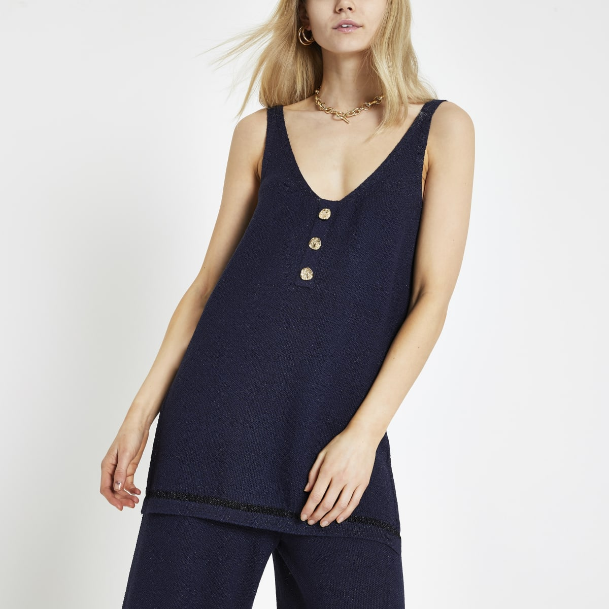 Marineblauw hemdje met glitter en V-hals