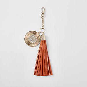 Schlüsselanhänger in Orange mit Quaste