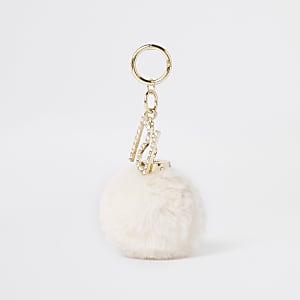 Crème sleutelring met pompon van imitatiebont