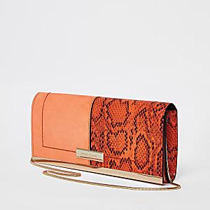 Oranje clutch met paneel met slangenprint