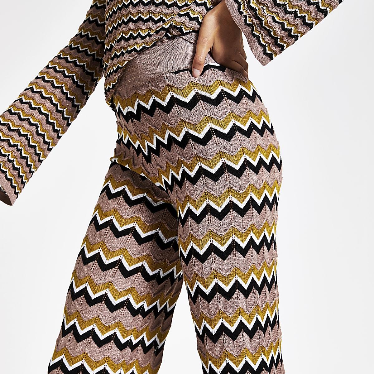 Beige gebreide broek met zigzagmotief