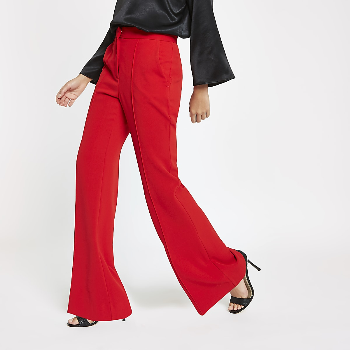 Red flared leg trousers