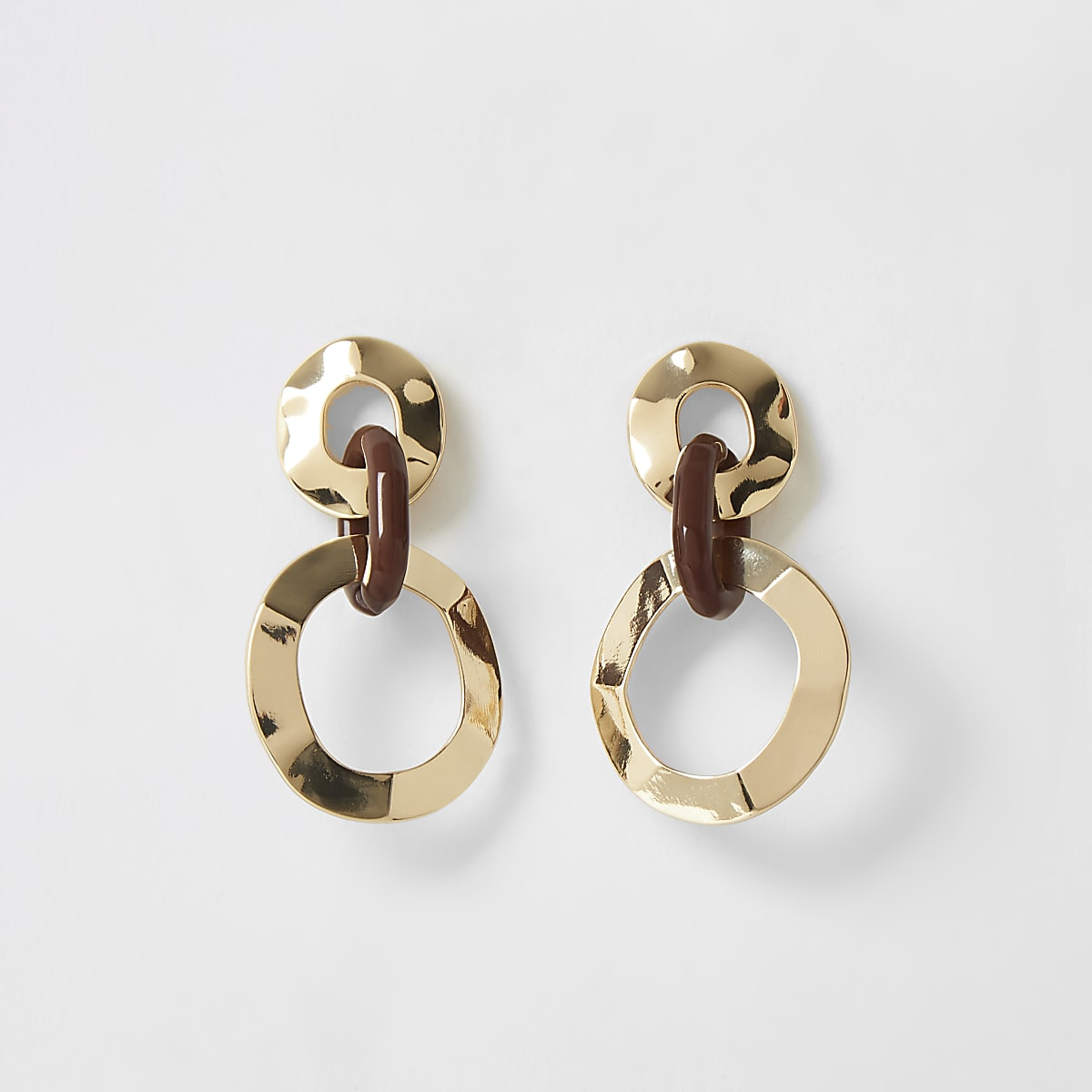 Gold color interlinked drop earrings