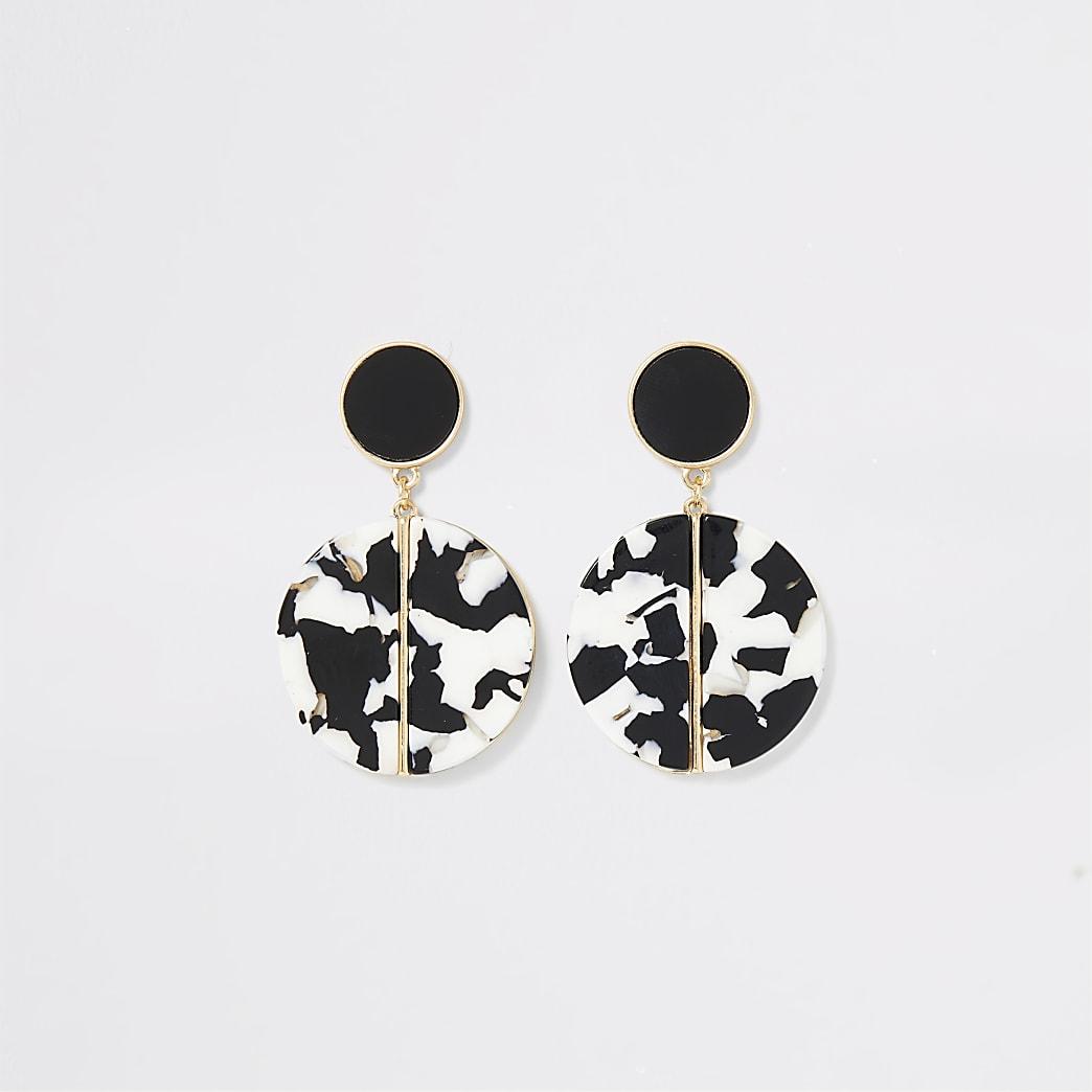 Pendants d'oreilles noirs et blancs en résine