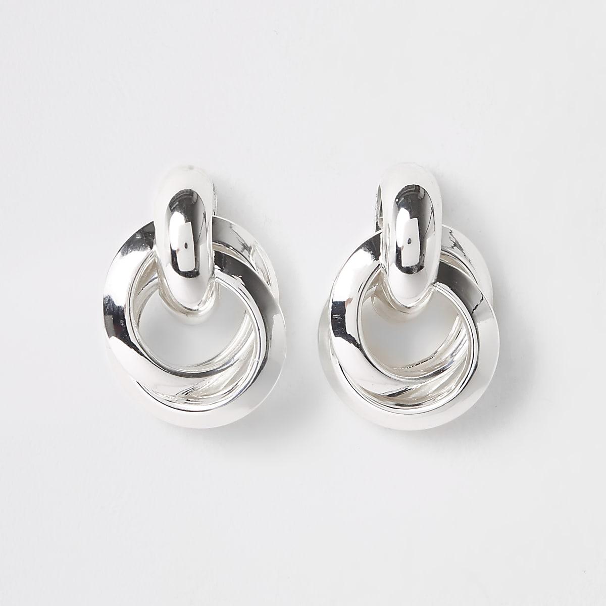 Zilverkleurige gedraaide oorknopjes met ring