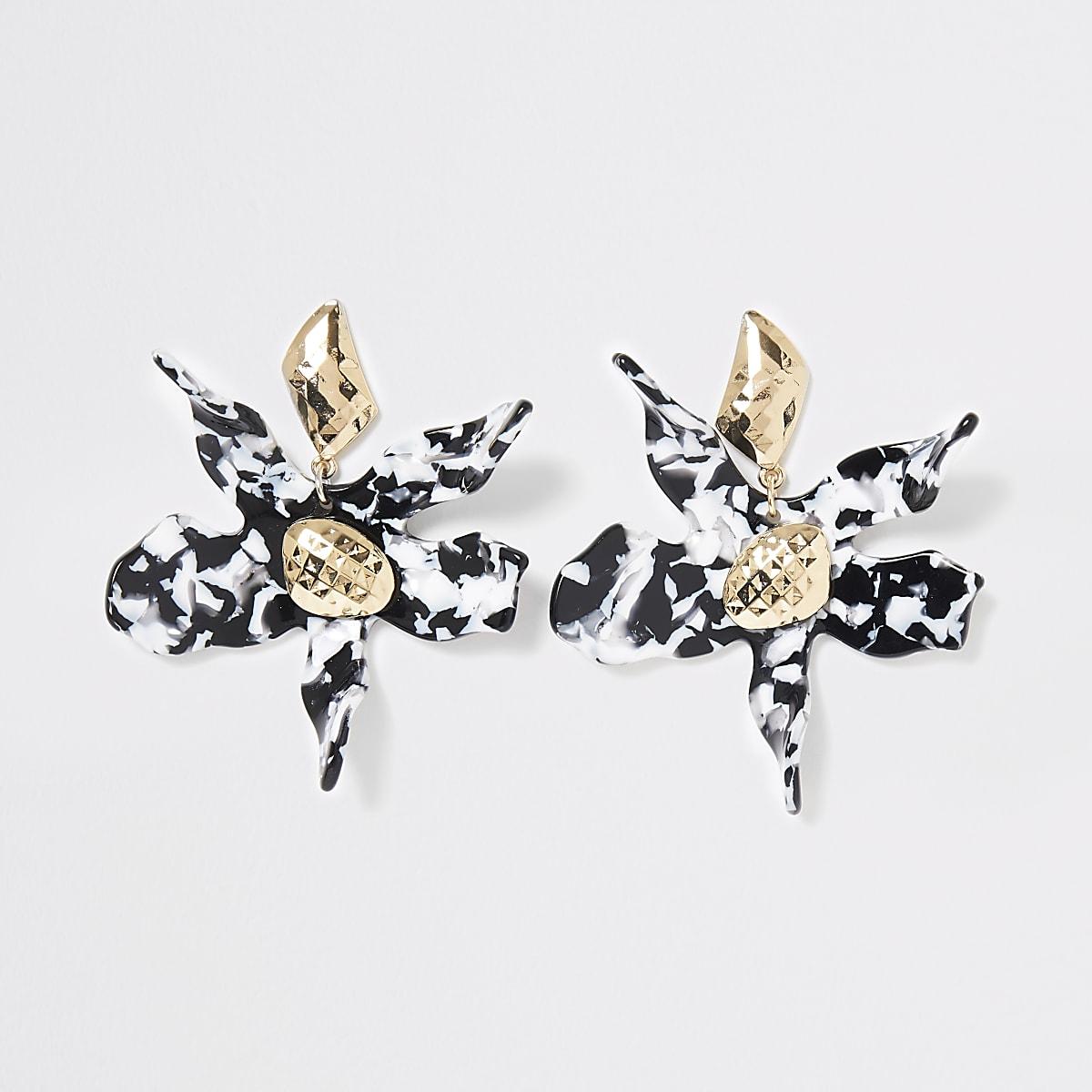 Pendants d'oreilles à fleurs noires et blanches