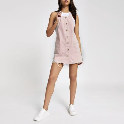 Pink denim pinafore dress