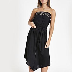 Combinaison bandeau de plage noire façon jupe-culotte