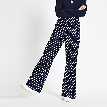 Navy spot print plisse flare trousers