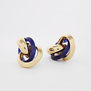 In elkaar gedraaide oorbellen met blauwe hars