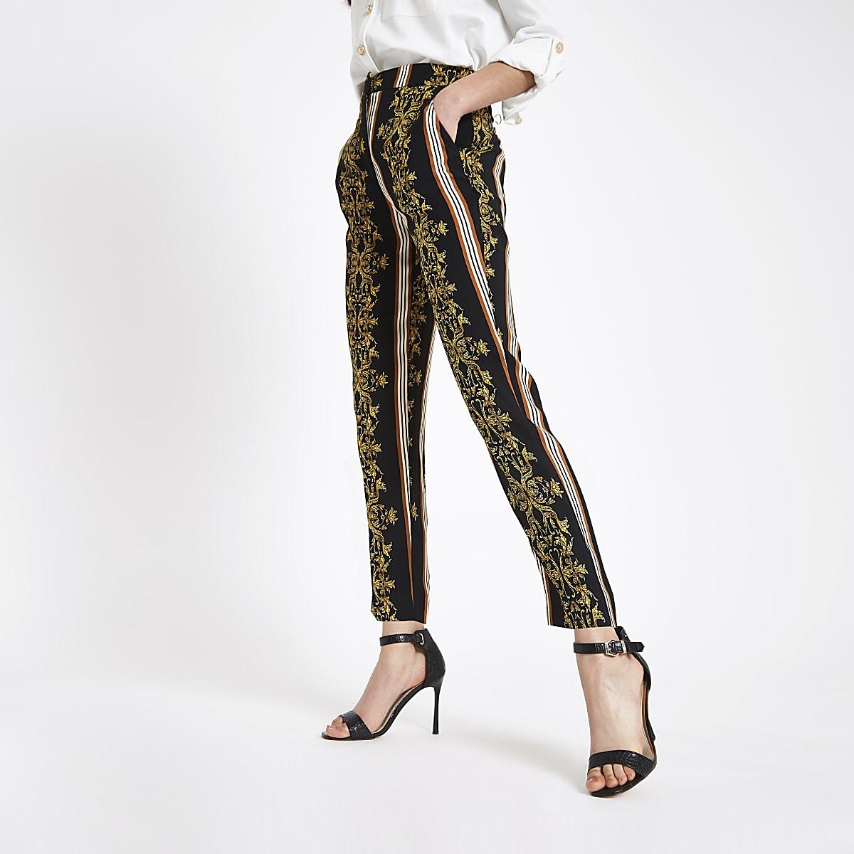 Zwarte smaltoelopende broek met barokprint