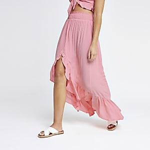 Jupe de plage rose à volants froncée