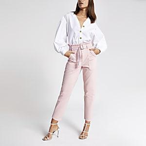 Roze denim jeans met geplooide taille