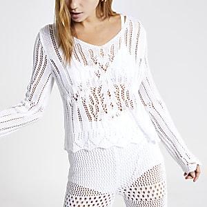 Witte gehaakte top met lange mouwen