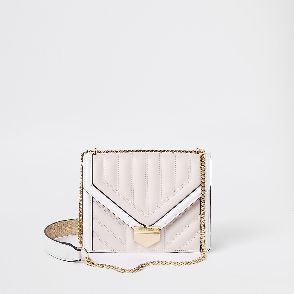 Pink and white quilted cross body bag