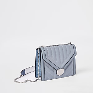 Blue quilted cross body bag