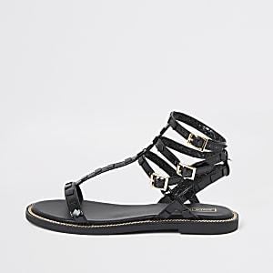 Black stud gladiator sandals