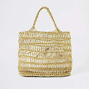 Gold metallic woven straw tote bag