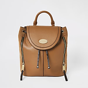 Brown flap over backpack