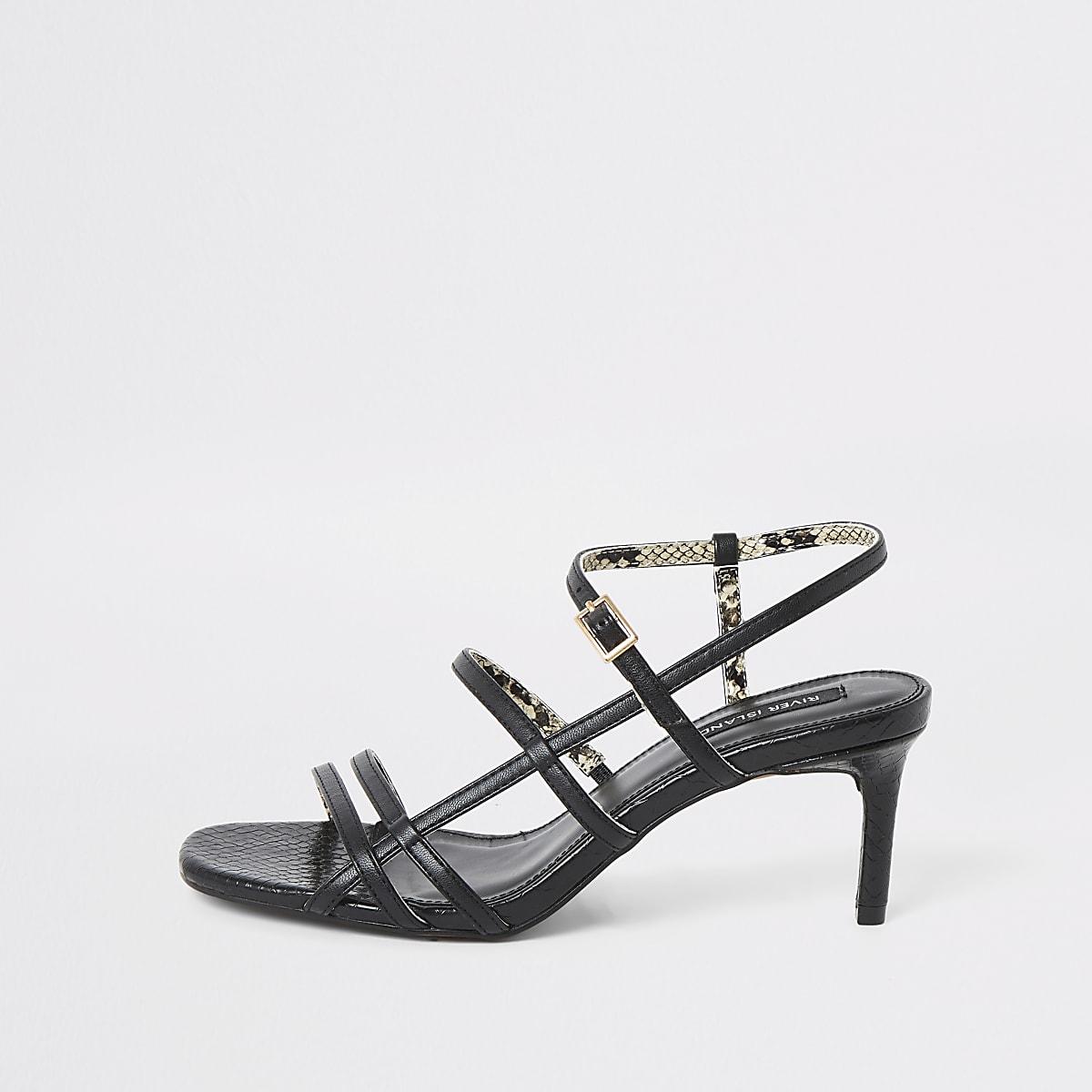 Black caged skinny heel sandals