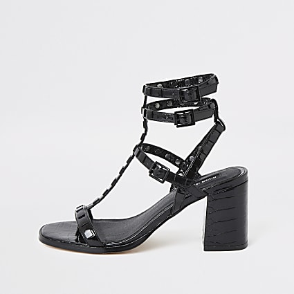 Black studded gladiator block heel sandals