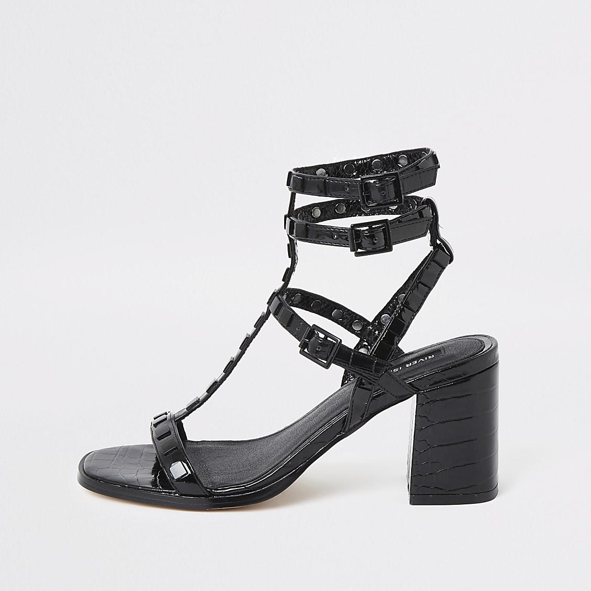 Black studded gladiator block heel sandals