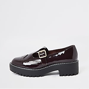 Dark red patent brogue shoes