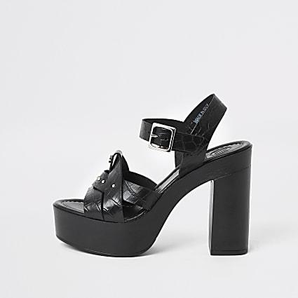 Black leather studded platform heels