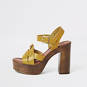 Yellow leather studded platform heels