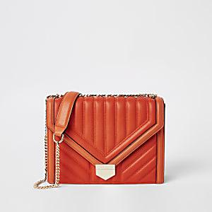 Orange quilted cross body bag
