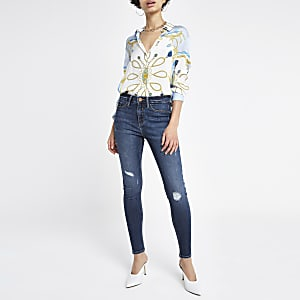 Molly - Middenblauwe denim ripped jegging met halfhoge taille