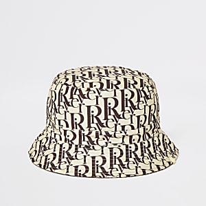 Bruin omkeerbaar hoedje met print en RI-monogram