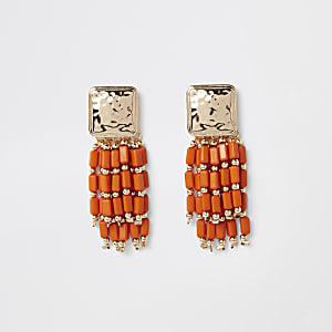Orange bead tassel drop earrings