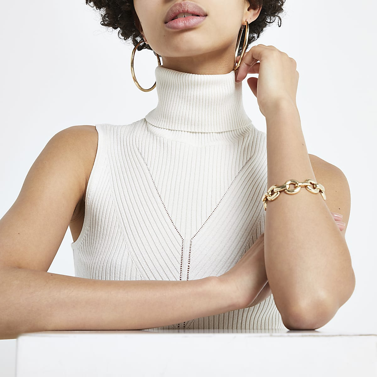 Cream ribbed roll neck sleeveless top
