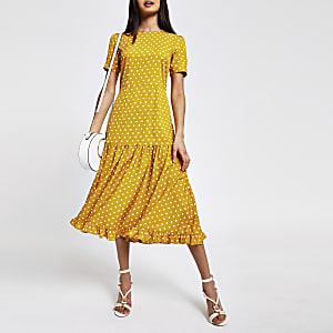 Gele midi-jurk met stippen