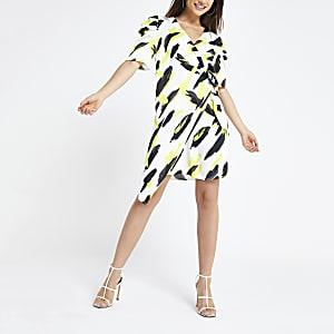 29bc12458ed8 Black print wrap swing dress