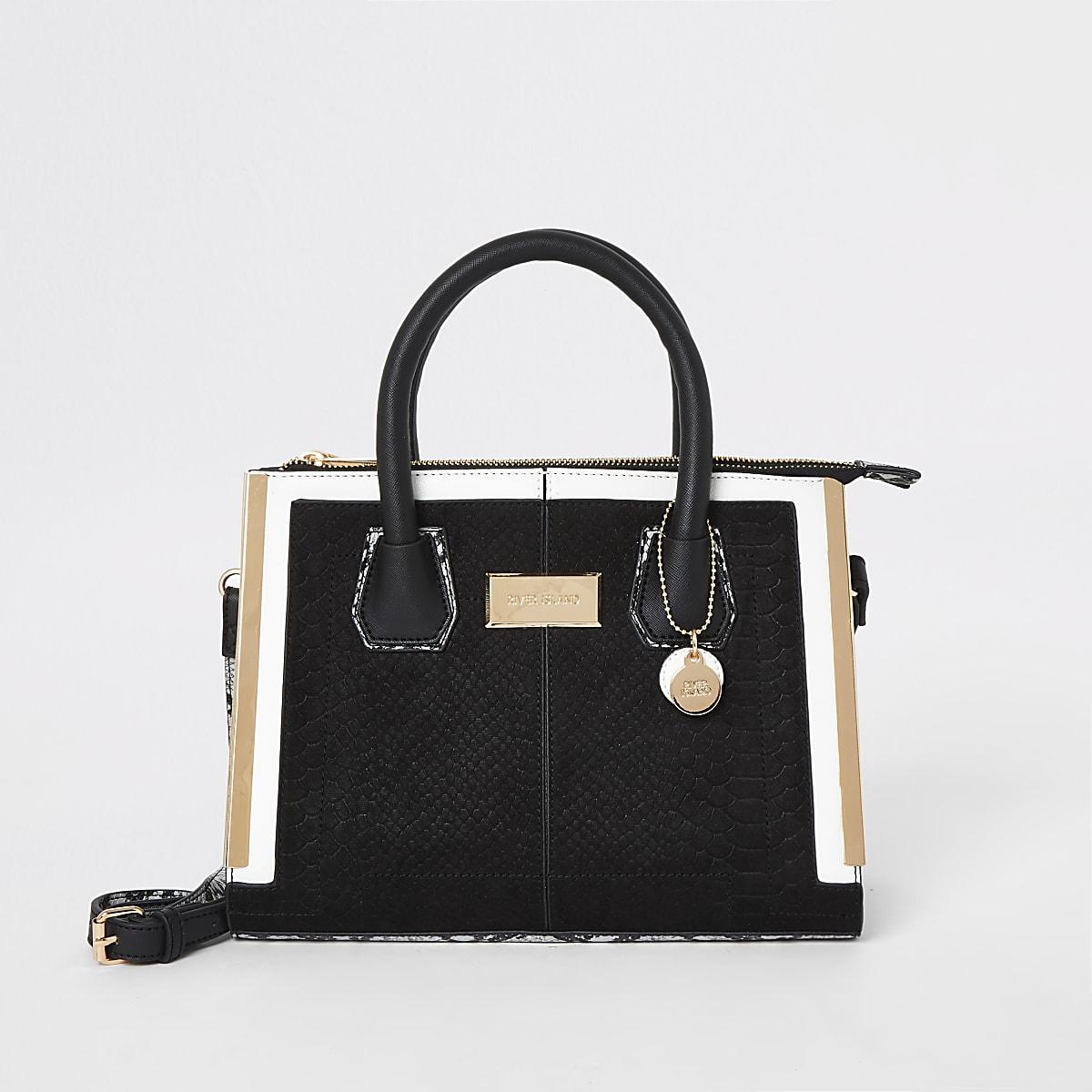 Zwarte handtas met goudkleurige rand