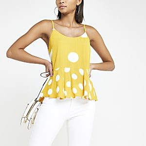 Yellow spot print peplum hem cami top