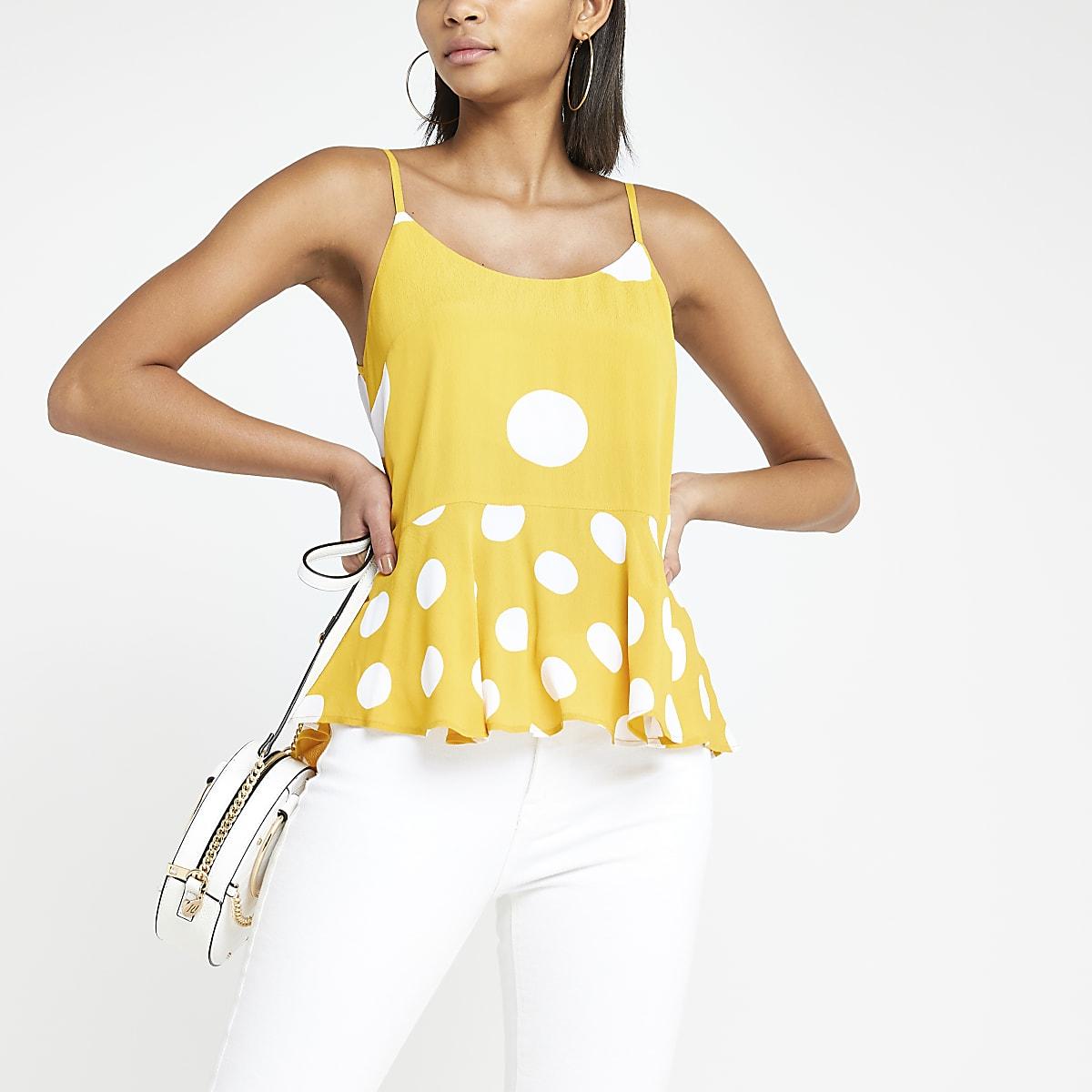 Yellow spot print peplum hem cami top
